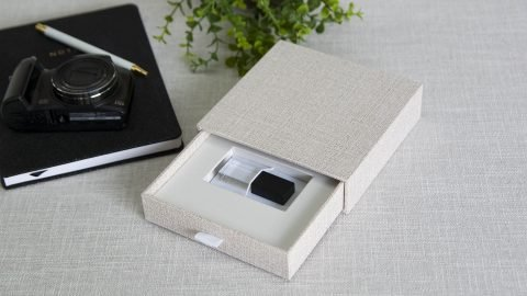 A Vanilla Sand Drawer USB box with a Black Crystal USB Drive displayed inside