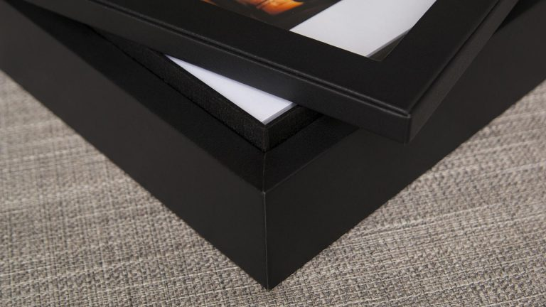 Designed with a sleek black leatherette texture