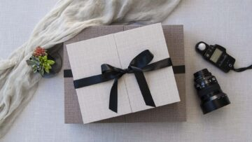 Lid doors are held closed by a decorative black satin ribbon