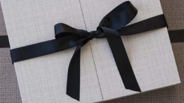Secure the lid with a black satin ribbon